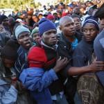 immigrants-rush-asylum-office-for-refugee-asylum-permits