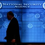 national-intelligence-director-john-negroponte-past-a-video-screen-at-national-security-agency-at-fort-meade