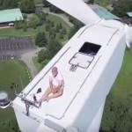 man-sunbathing-on-wind-turbine