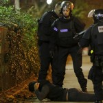 a-man-lies-on-the-ground-as-french-police-check-his-identity-near-the-bataclan-concert-hall-following-fatal-shootings-in-paris-france