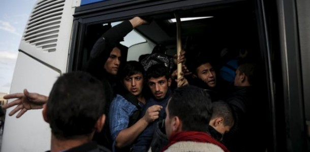 refugees-and-migrants-are-squeezed-inside-a-bus-after-arriving-by-the-blue-star-patmos-passenger-ship-at-the-port-of-piraeus-near-athens