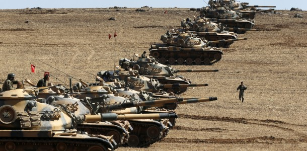 Turkish army tanks take up position on the Turkish-Syrian border near the southeastern town of Suruc in Sanliurfa province