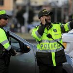 police-work-close-to-the-scene-where-a-car-bomb-exploded-according-to-authorities-in-bogota